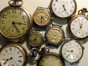 старовинний кишеньковий годинник